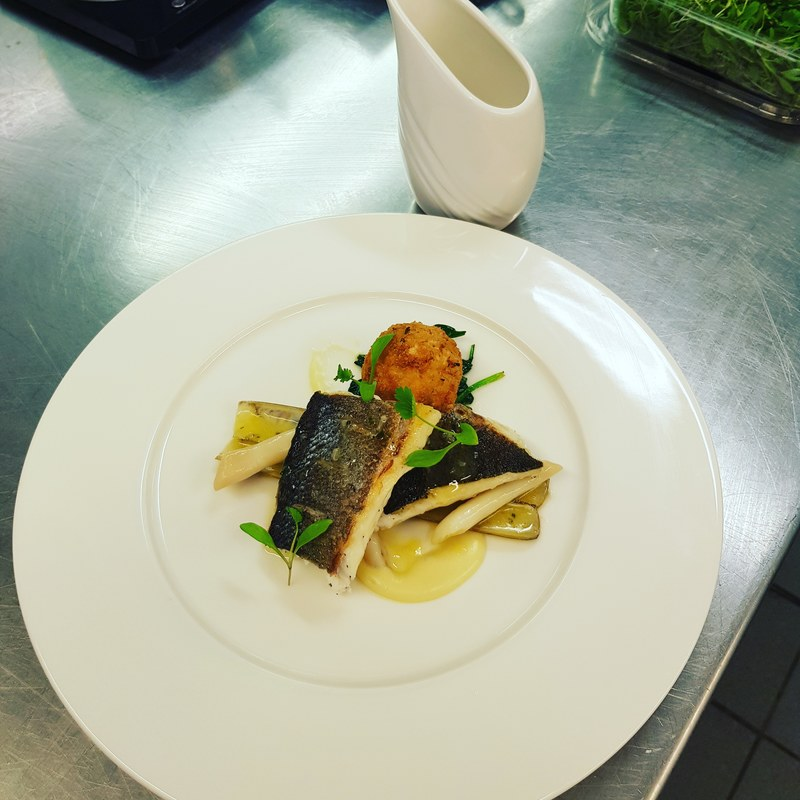 Fish course part of a 5 course taster menu  sea bass