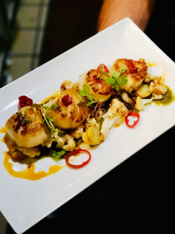 Hokkaido Scallops , Green Tomato Emulsion , roasted potato and cauliflower with white hominy, Fresno peppers :hot_pepper:, Garnish with Crispy Tasso ham and chili :hot_pepper: oil