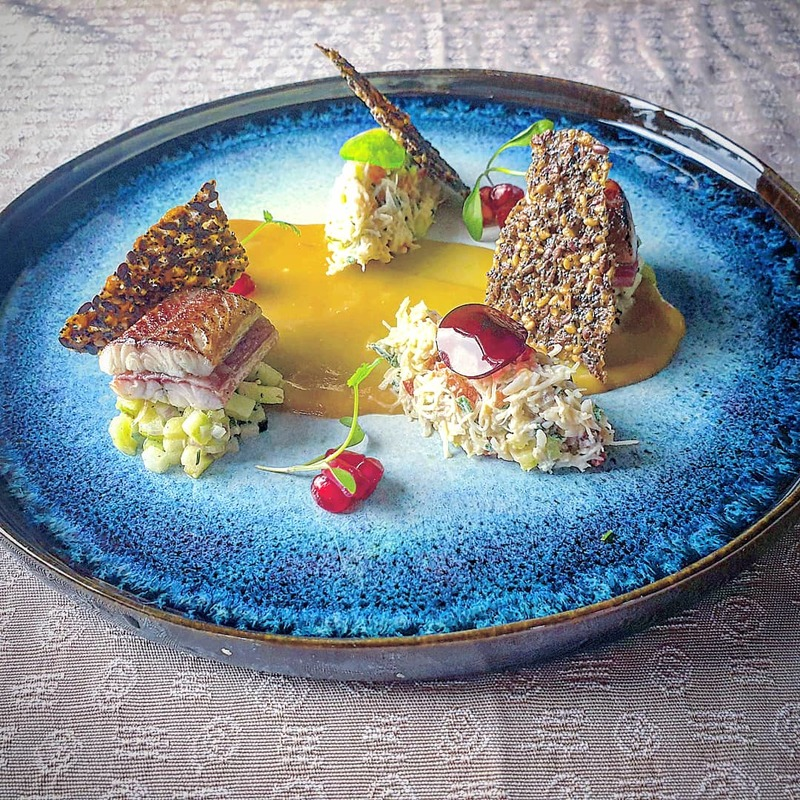 Lambay crab salad. Scorched smoked eel, flavours of apple cucumber and pomegranate, mixed seed tuile.