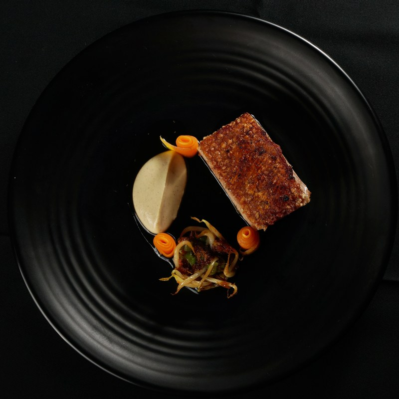 Basa Gede Pork Belly, cauliflower puree, lawar Bali, acar, & pork jus