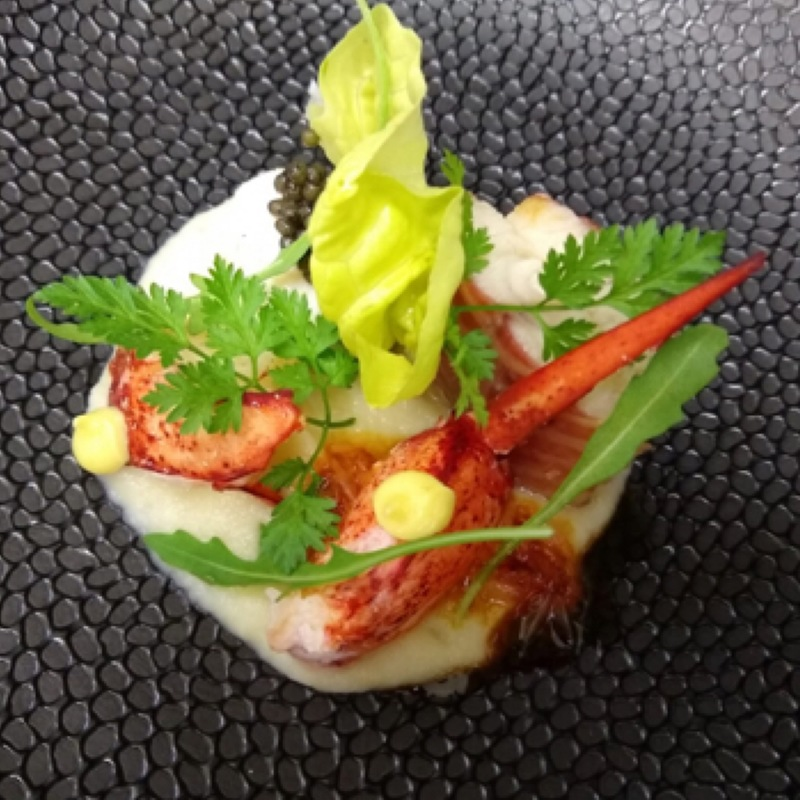"Maine Lobster, Smoked Eel, ""Anna"" Dutch Caviar, Romaine Hearts, Cream of Salsify, Warm Vadouvan Vinaigrette."