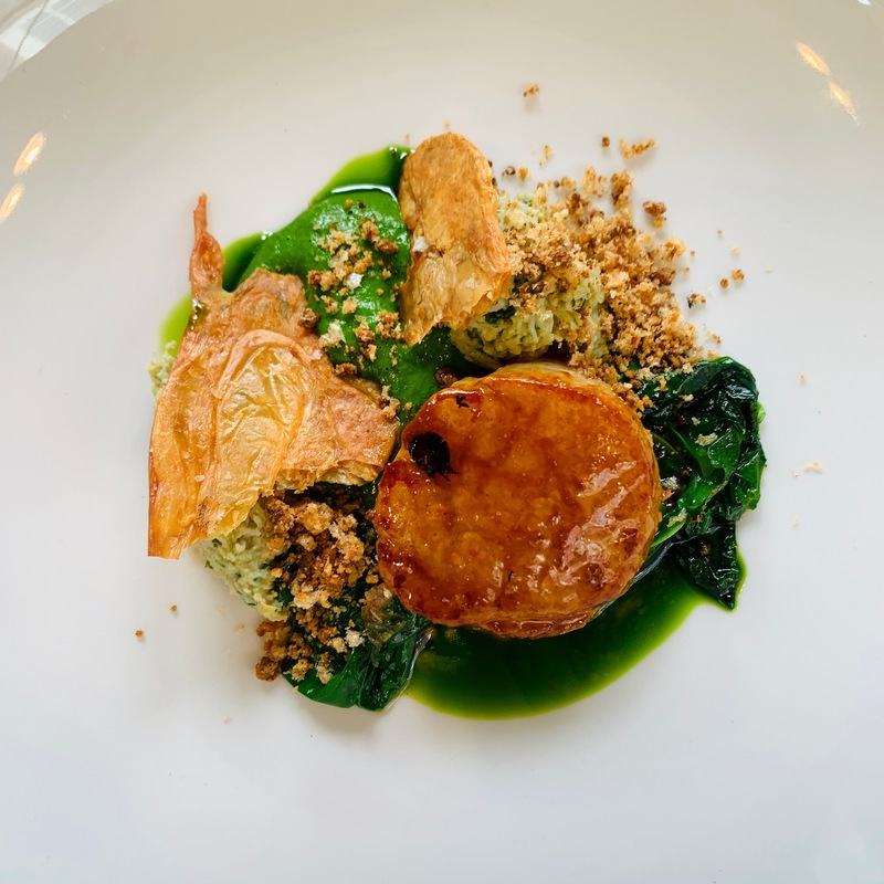 Chicken glazed scallop, crab, wild garlic, chicken skin crumble