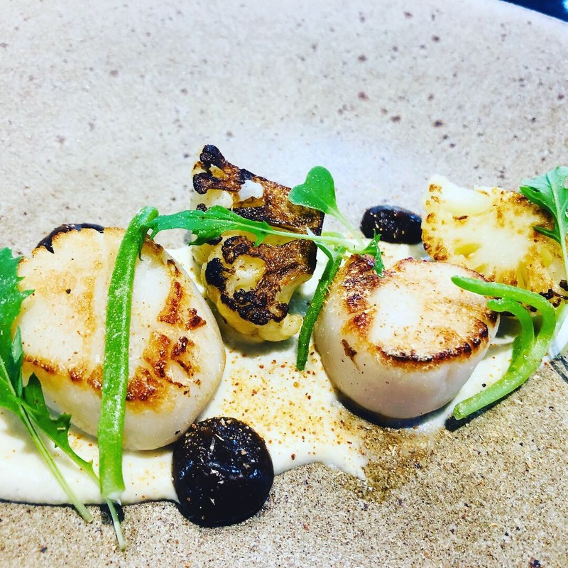Seared scallops, cauliflower purée , charred cauliflower, caper and raisin purée, salty fingers, roe powder, micro mizuno