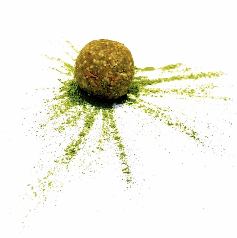 Golden berry, pistachio, matcha & maple protein ball.