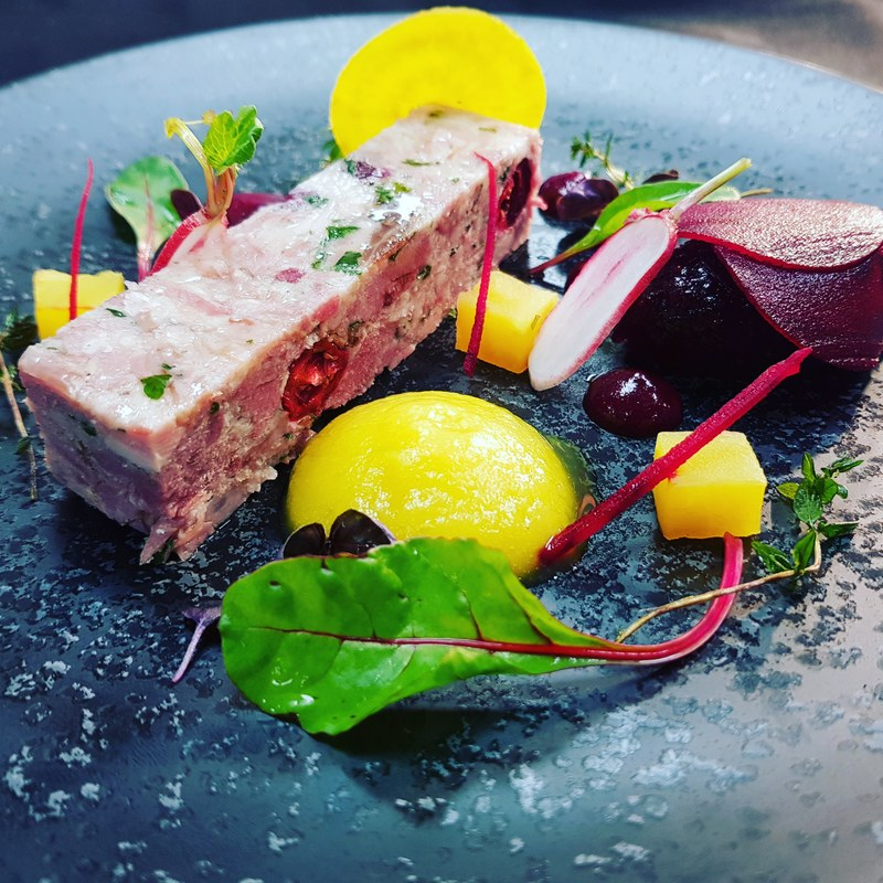 Same dish plated 2 ways smoked ham hock terrine textures of beetroot, cranberry and beetroot chutney