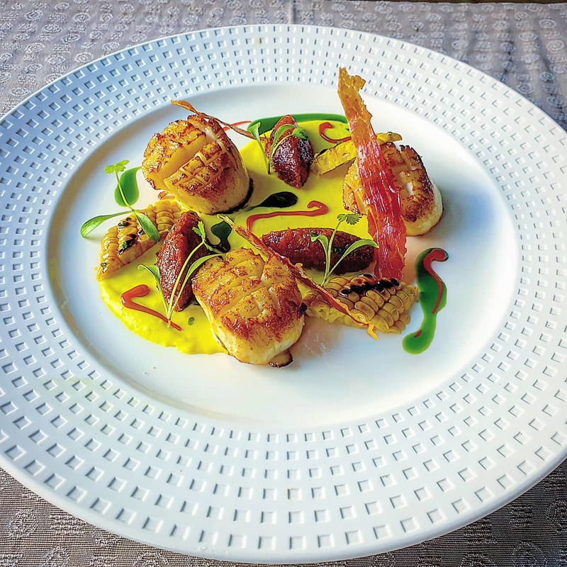 Roast kilmore quay scallops. Charred corn puree, chorizo jam, prosciutto crisps, chorizo and coriander oil.