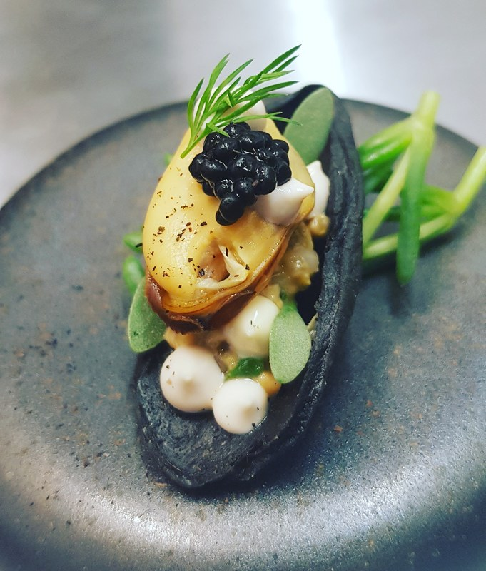 Shetland mussels poached in sea weed, edible mussel shell, taramasalata, sea weed emulsion and caviar.