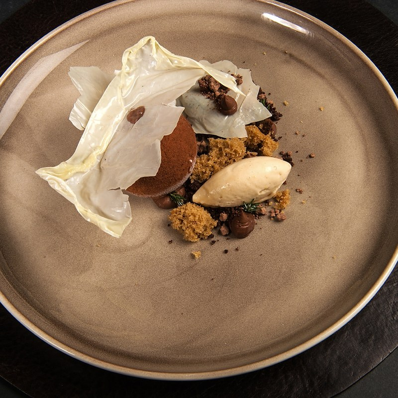 Coffee and chocolate parfait, coffee sponge,milk skin crisp ,dark chocolate namelaka and sweet cicely.