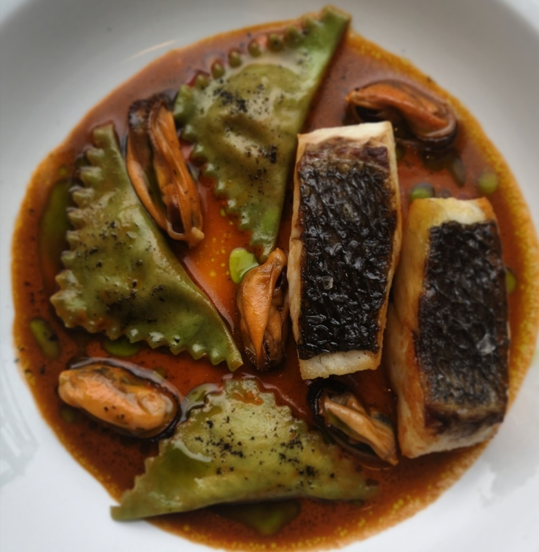 Pan fried stone bass, spinich and truffle of the sea pansoti stuffed with smoked salmon and sundried tomato mousse, mussels in a shellfish and chilli sauce and herb oil.