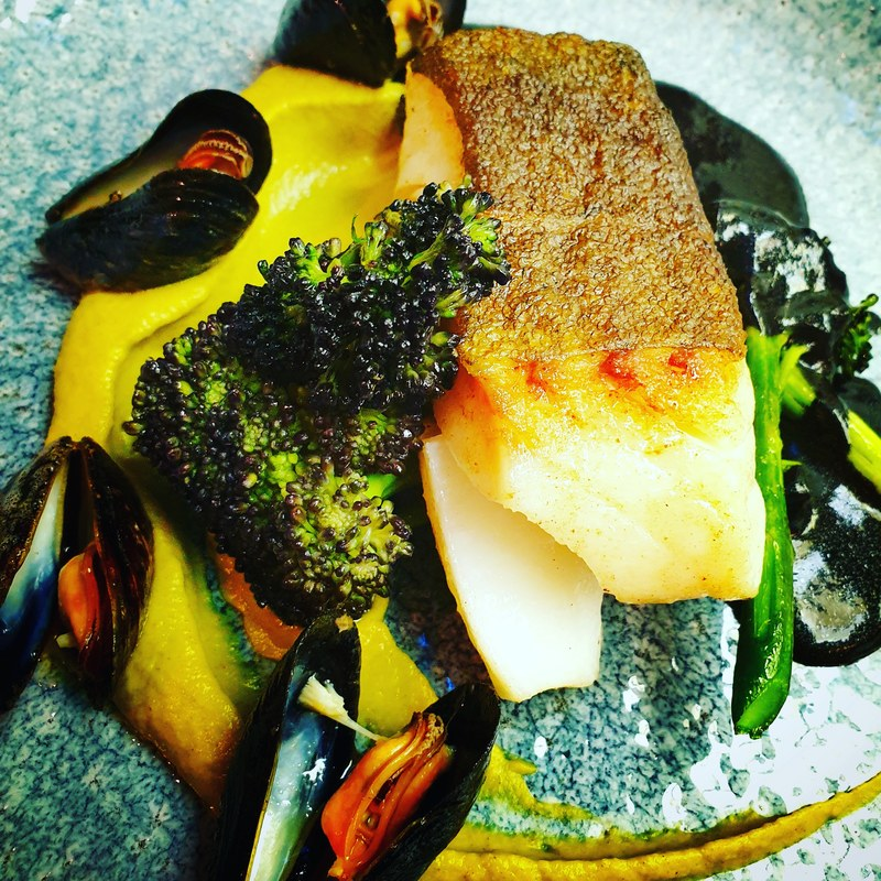 Taking advantage of the stunning skrei season. Served with purple sprouting broccoli, broccoli puree, squid ink sauce & butter poached welsh mussels.