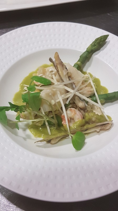 Poached scallop, razor clam and prawns, pea and asparagus emulsion, confit leeks, garden watercress, enoki mushrooms