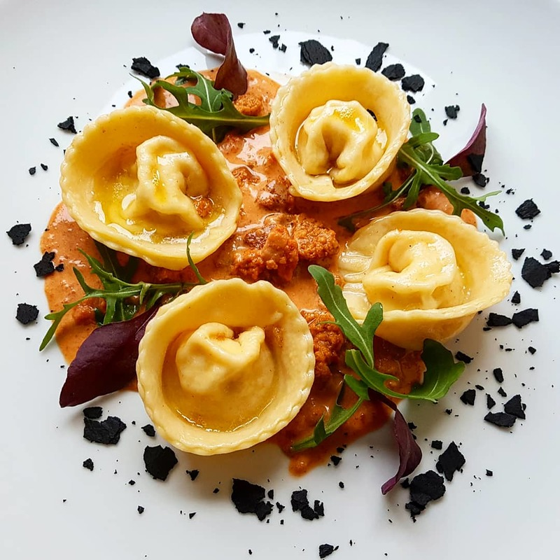 Tortellini stuffed with braised monkfish cheeks on brown butter•sea urchin cream sauce•squid ink chips... Throwback!