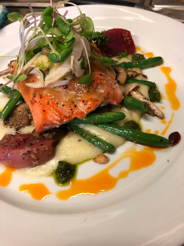 Maple miso glazed sockeye salmon, potato leek purée, apple braised watermelon radish, sautéed forest mushrooms, green beans, apple fennel salad