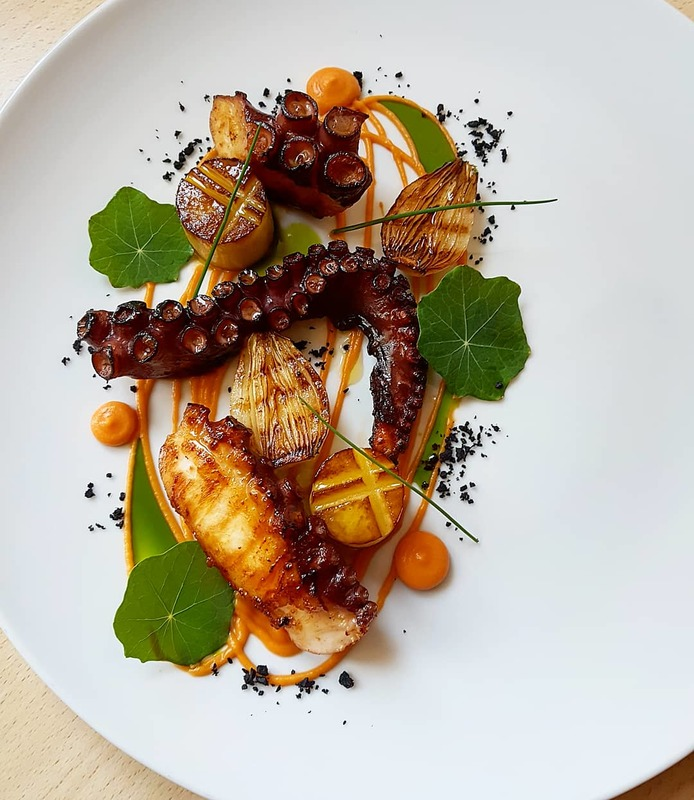 Charcoal grilled octopus•romesco with smoked paprika•potato fondant•charred onion•chive oil•dehydrated black olives...