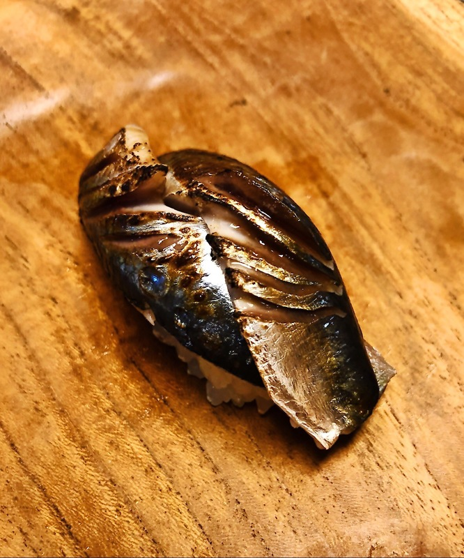Iwashi Aburi / torched sardine. Purple shiso beneath