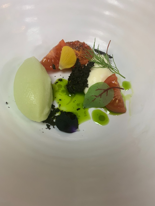 Chervil sorbet, whipped goats curd, basil and heritage tomato, finished with a tomato water table side