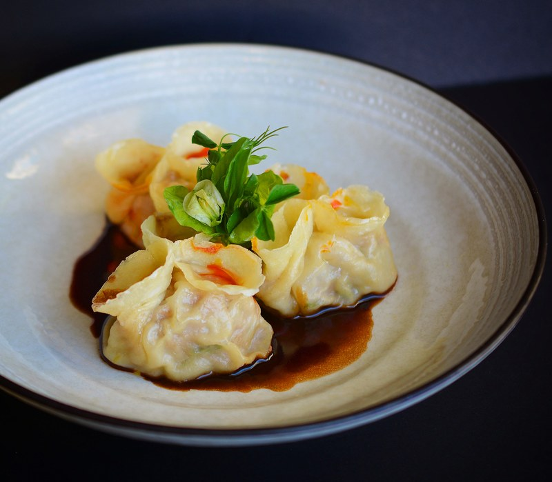 Duck and foie dumplings with burnt onion  sauce and chili oil