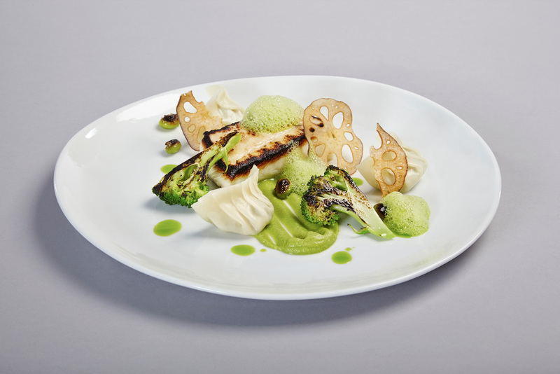 Halibut, blackened with sweet soy, charred broccoli, edamame, edamame and coriander froth, lotus root crisps, coriander oil...