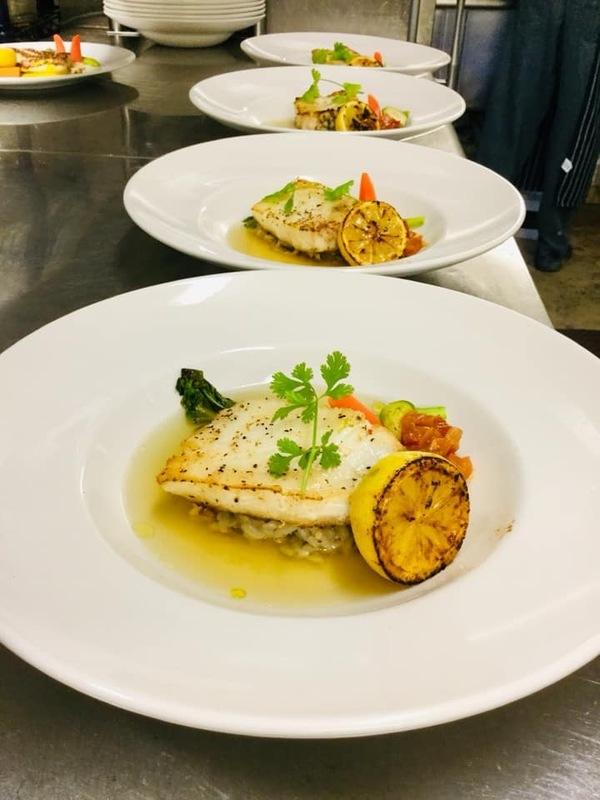 Roasted Chilean SeaBass+ Braised Root vegetables+ Stewed tomatoes + Caribbean boil fish Broth+black truffle risotto