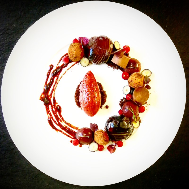 Variation of Bavarian Plum: Tartelette with chocolate shortcrust, icewineglace and fresh plum, Roasted Plum-Bordeaux Sauce, Redwine-Plum Ice, gelee of plum, Chocolate-Plum Praline, Chocolate Crumble