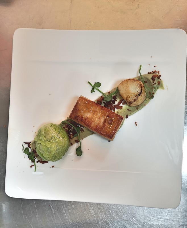 Braised belly pork, artichoke heart puree, king scallop and savouy parcel.