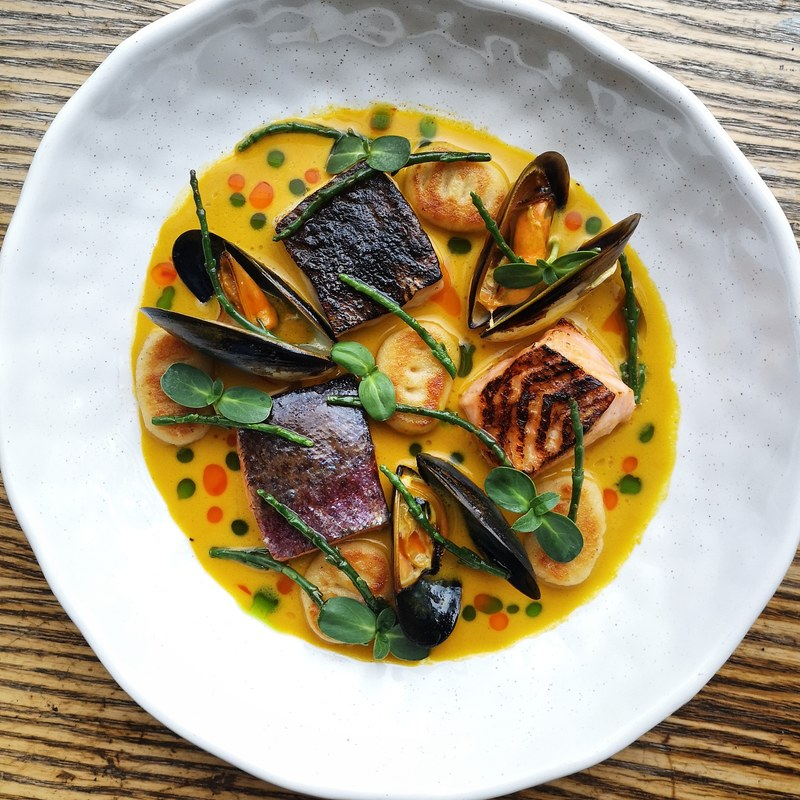 Rainbow trout, sea bream, salmon and mussels, shellfish, beer and saffron bisque, gnocchi, samphire and sun shoots.