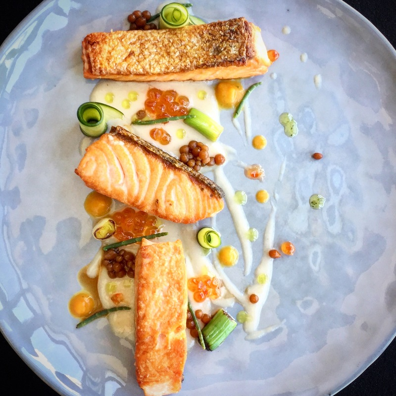 Grilled salmon |  pumpkin cream and salicornia |  lychee sauce |  leek baby | marinated sweet cucumber | soy sauce caviar |  salmon roe |  dill oil.