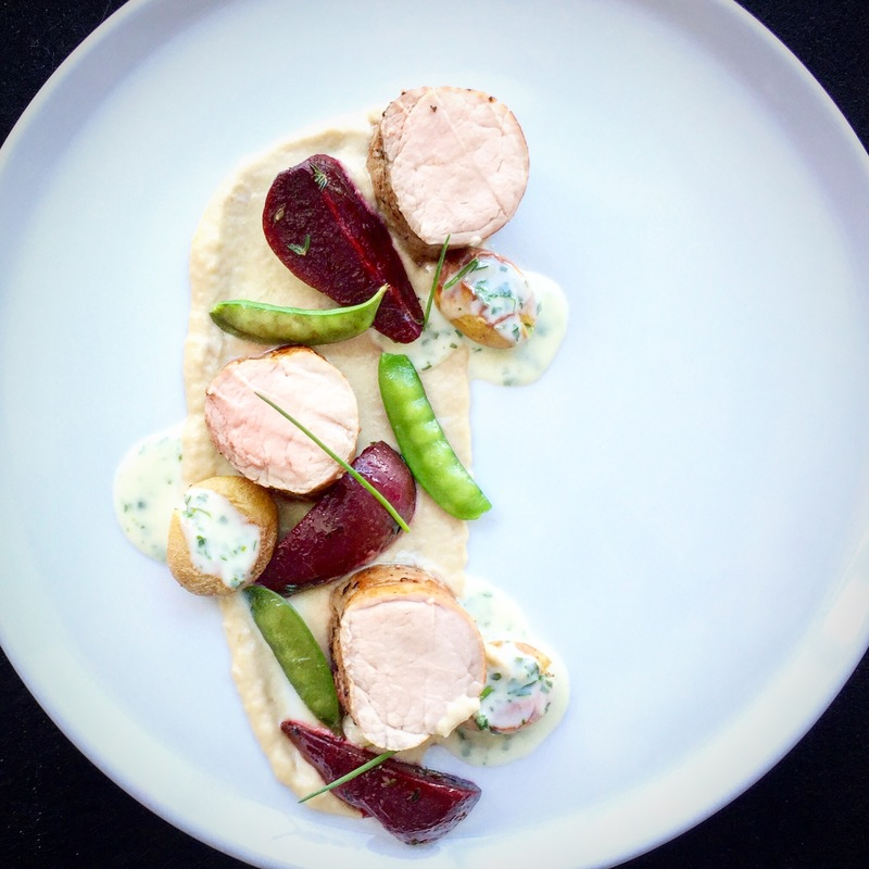 pork loin |  puree of shallots |  beet and thyme |  peas |  baked potato |  parsley sauce.