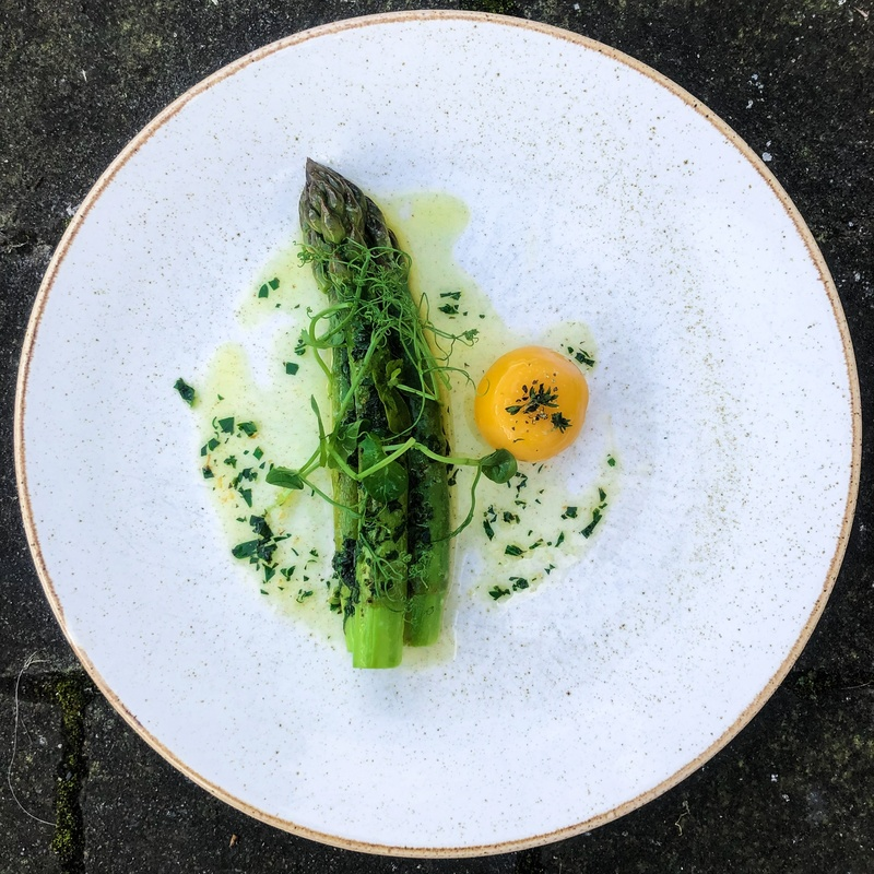Wye valley asparagus • burnt thyme butter • slow cooked duck egg yolk • pea shoots