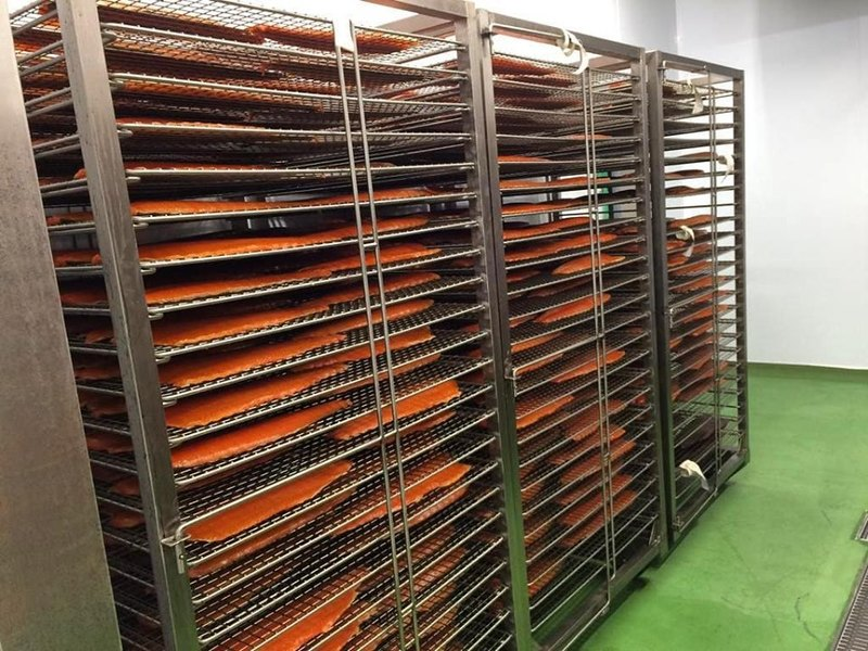 Salmon resting on the racks before packing.