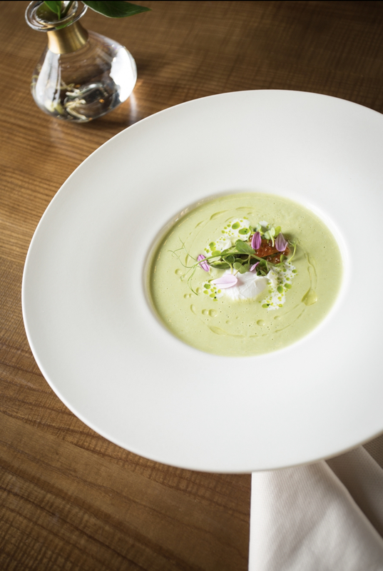 Asparagus cream soup with poached egg and red caviar