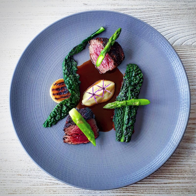 Roast fillet of Kilkenny rose veal, braised brisket (underneath), charred black kale, asparagus, onions, gravy