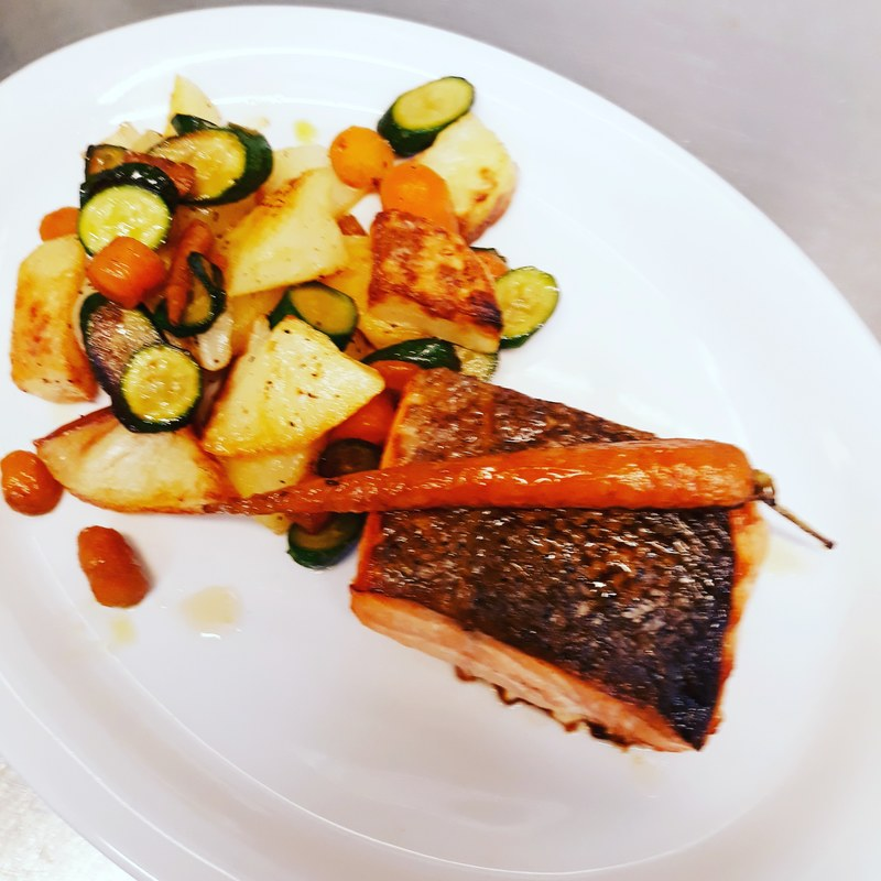 Roast potatoes and mixed roast veg and salmon fillet