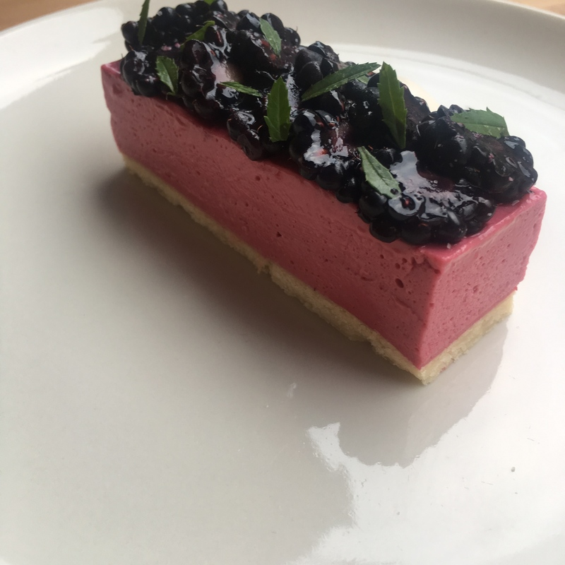 Blackberry curd tart, sour cream, marigold