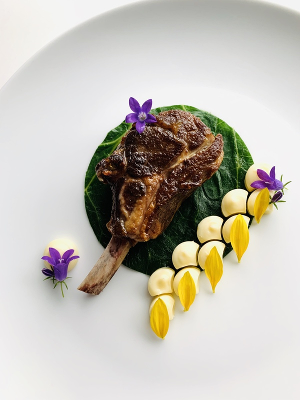 Bajan bees wax 48 day Aged.lamb rack, clove & scotch bonnet steamed cabbage leaf, Parsnip & bay leaf mash With clove lamb jus