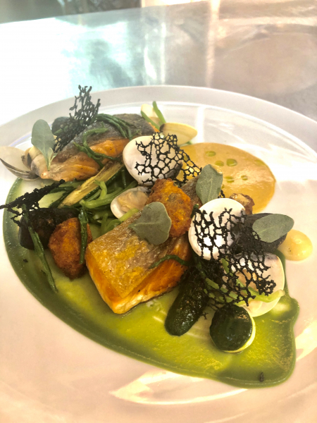 Pan fried salmon, squid ink gnocchi, courgette, clams, smoked mussels, sea vegetables, squid ink tuille, shellfish bisque