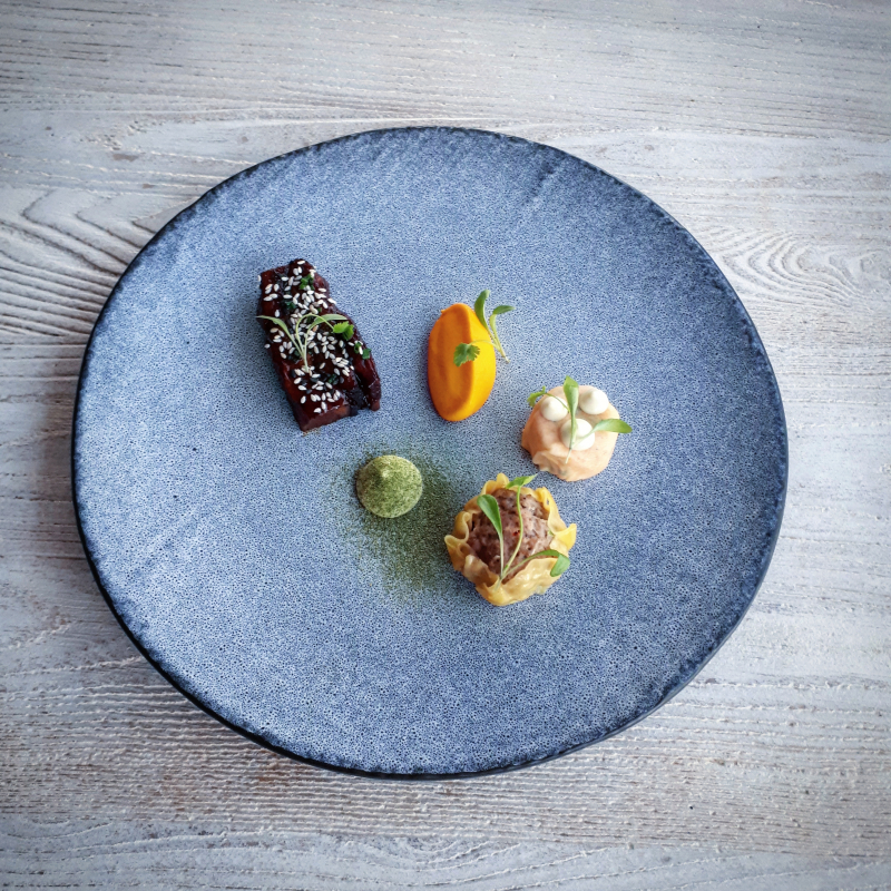 Sesame and soy glazed pork belly, asian style pork dumpling, carrot and ginger puree, carrot and coriander slaw, wasabi and lime mayonnaise