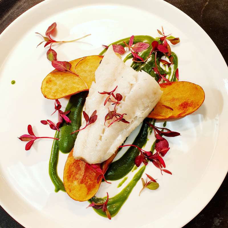 """Boat fish"" Seared Hake, butter Confit new potatoes, Spinach fish sauce and red amaranth."