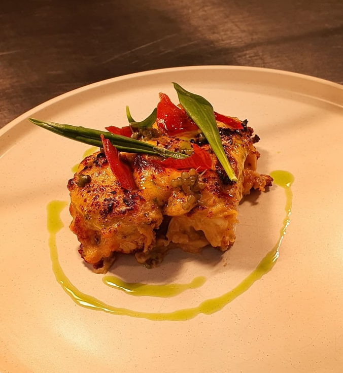 Cauliflower rarebit, serrano ham, young wild garlic and last years wild garlic capers
