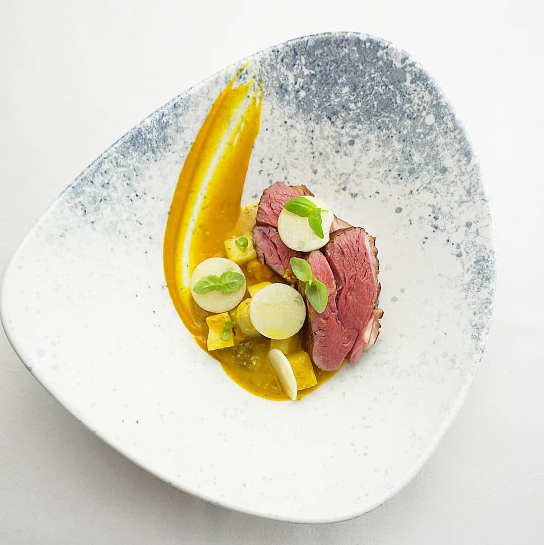 Roasted lamb rump with squash curry