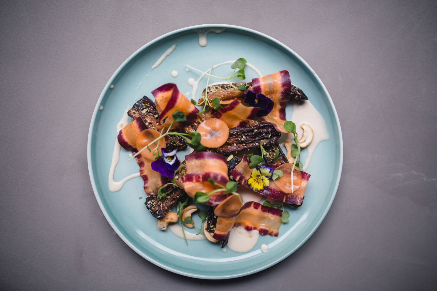Maple syrup charcoal grilled carrots, cashew tahini, pickled carrot shaves and duhkkar,