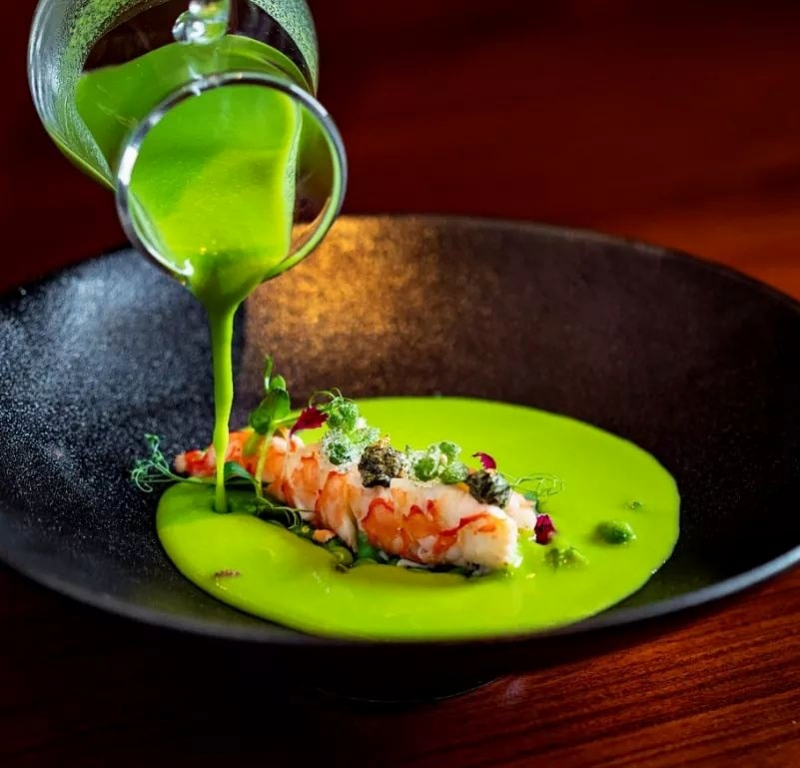 Green pea soup, poached Omani prawn, seaweed, buttered peas.
