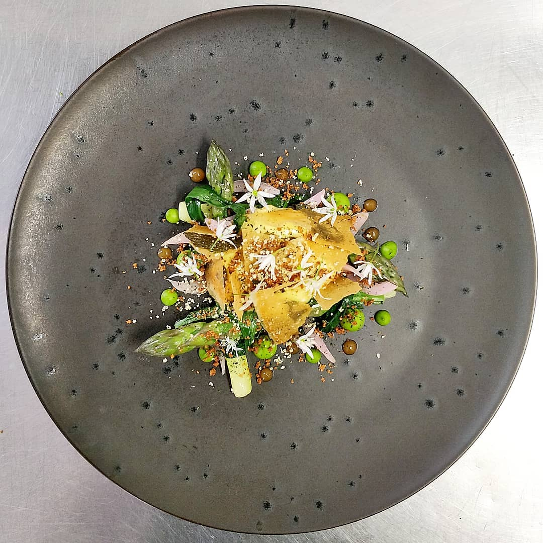Yorkshire Asparagus, Brown Butter Hollandaise, Wild Garlic, Pickled Onion, Brown Butter Crumb, Onion Ketchup, Cured Egg Yolk.
