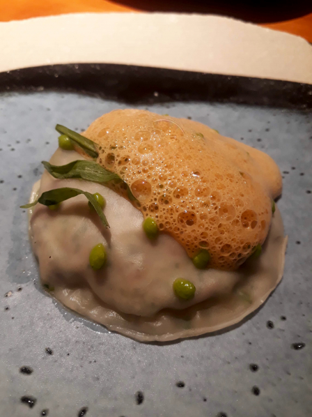 Snail gyoza, green peas and tarragon, langoustine bisque