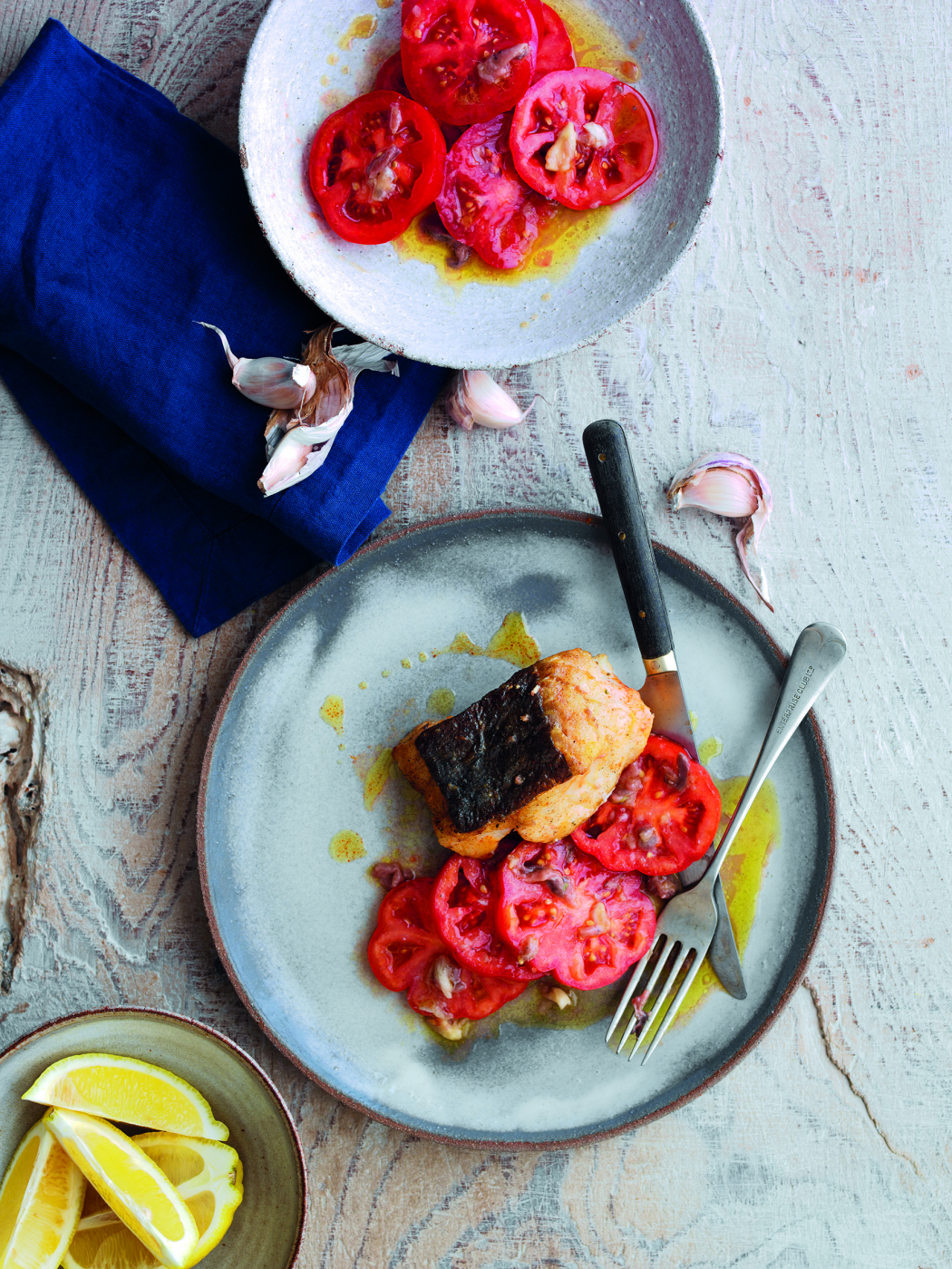 Roast Norwegian cod with vine tomato and anchovy salad