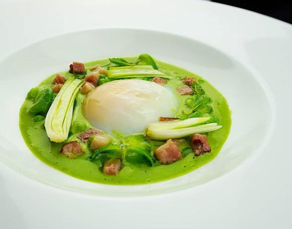Slow cooker hen's egg with pea nage, broad beans, and boczek