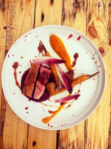 Duck breast,spuced carrots ,beetroot puree,carrot and orange puree,cherry jus