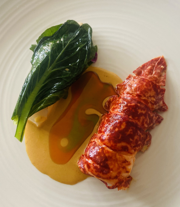 Stunning Cornish lobster 🦞 from @wildharbour poached in lemon grass infused butter, Lacto -Fermented turnips, Choysum,lobster bisque flavour with ginger , kafir lime