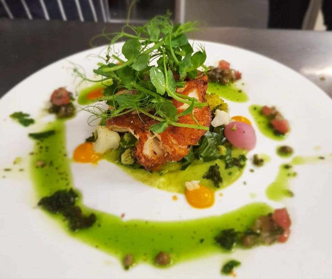 Cajun cod with sauce vierge, pea puree and seasonal veg.