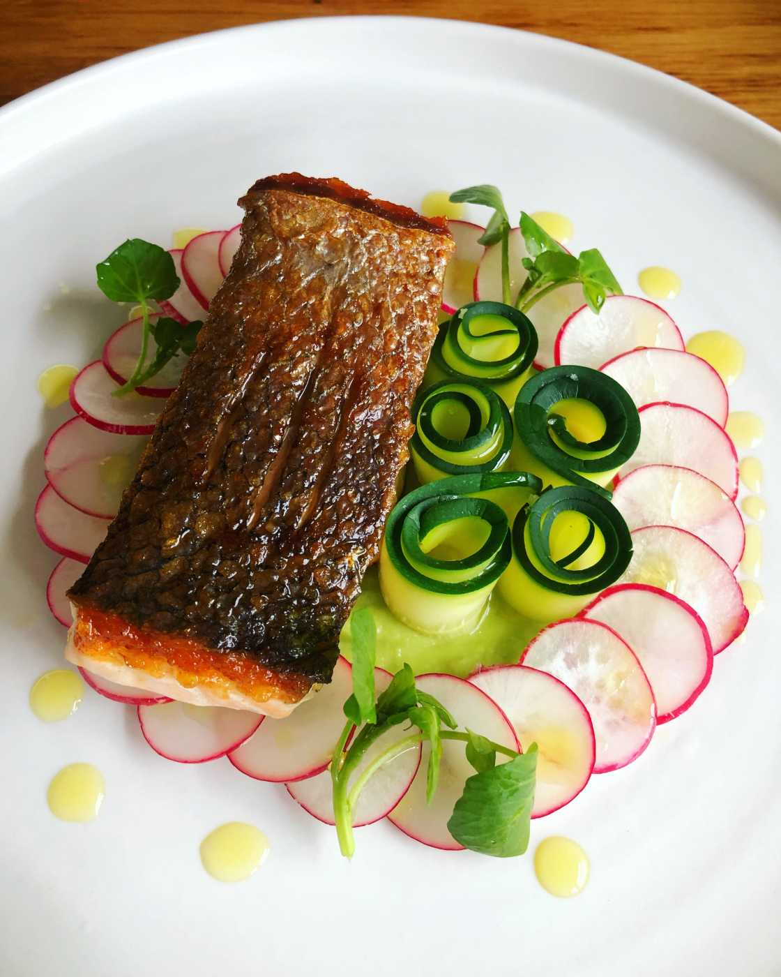 Crispy skin salmon, avocado purée, courgette ribbons, radish & watercress.